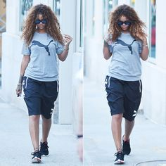 Rihanna wearing Puma cat logo t-shirt, logo shorts and Carson running shoes