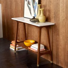 Reeve Mid-Century Console $799 Set in stone. With its marble top and pecan-stained solid wood base, the Reeve Console's compact size makes it ideal for a hallway or behind a sofa. 117 cm w x 36 cm d x 81 cm h. Wood base in Pecan, marble top. Imported. Retro Furniture, Classic Furniture, Furniture Decor, Furniture Design, Antique Furniture, Rustic Furniture, Outdoor Furniture, Simple Furniture, Furniture Dolly