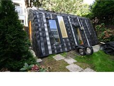 Maisongomme by Refunc is not your average garden shed, unless your neighbors are also building theirs from old tires and upcyled window frames  Read more: 5 Brilliant Backyard Sheds Built from Recycled Materials 6 Brilliant Sheds Made from Recycled Materials - Gallery Page 2 – Inhabitat - Sustainable Design Innovation, Eco Architecture, Green Building