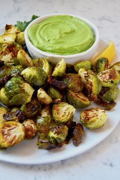 These Crispy Brussels Sprouts with Avocado Green Goddess Dressing are a delicious and nutritious veggie side to pair with your d