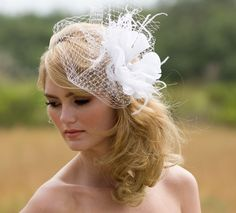 Unique Wedding Veil, Feather Fascinator, True White, or Ivory, Birdcage Veil, Silk Flower, Bridal, Removable Blusher Veil, Pearl, Crystal. $149.00, via Etsy.