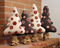 Adorable trees for holidays sew felt, add buttons, stuff, add wood trunk covered in burlap, add bow