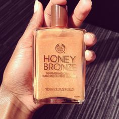 "Beach Beauty Pick #1: ""I love Honey Bronze Shimmering Dry Oil, because it gives my body a gorgeous shimmering glow!"" - Charlotte, The Body Shop Team, 25"