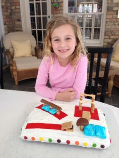 Gymnastics cake for 7th birthday.  The red is all fruit strip.  The beam/vault are tootsie rolls (melted slightly in microwave and molded).  The blue mats are marshmallows painted w/water/blue food coloring.  The springboards are graham crackers cut and propped w/half a junior mint (held w/a dollop of frosting).  The vault post, beam/bar legs are cut piroutte cookies.  The bars themselves are breadsticks.  Can't forget the rainbow skittles around the edge to jazz it up.  My daughter LOVED…