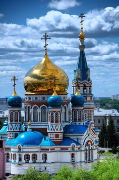 The Dormition Cathedral in Omsk is one of the largest churches in Siberia. Its fanciful design of many shapes and colors utilizes a plethora of elements from the Russian and Byzantine medieval architectural vocabulary. The main square of Omsk takes its name from the cathedral. Omsk. Russia.