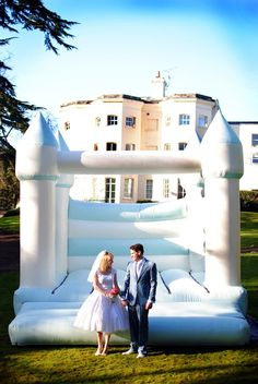 i would loveee to have a bouncy castle at my reception! i want such a fun wedding