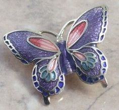 Purple cloisonne butterfly pin = Awww when my son was 8 or 9, he saved up his allowance and bought me a pin similar to this one at the schools Christmas Bazaar because he knew I loved butterflies. Such a sweet memory & I still have the little pin all these years later. <3