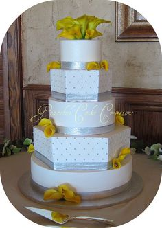 Elegant White and Silver Wedding Cake with Yellow Calla Lilies by Graceful Cake Creations, via Flickr