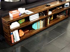 """$1800  Ebony-Macassar bookcase console by DLdesignworks offers elegant display for volumes of books, magazines, framed photographs and more. Ideal too for your office supplies or decorative items. With its clean lines and simple design, the bookcase console fits into modern and more traditional decor alike.    Dimensions: 72"""" long, 10"""" deep and 24"""" high.    Custom size available. Please specify your dimensions.  Available also in Walnut, Maple, Cherry"""