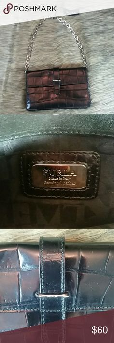 Genuine Furla Embossed Crocodile Leather Purse Italian Designer Furla black embossed crocodile leather front flat shoulder bag. Single chain shoulder bag with a fold over flap with magnetic closure. Sold at Neiman Marcus and Saks Fifth Avenue. NWT. No trades. Thank you for viewing. Furla Bags Shoulder Bags