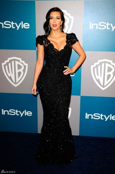 KIM KARDASHIAN. I like the idea of a black lace dress with sequins. This neckline is ideal if you have curves.