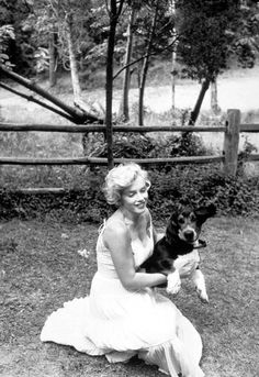 Marilyn Monroe and her basset hound Hugo photographed by Sam Shaw at her Roxbury estate, 1957.
