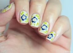 Dotted flowers (5 dots in round), but with added stripes on this one - I like that =) Wondrously Polished: Collaboration with Cocktails & Joints!