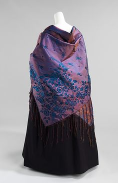 Purple silk shawl, American, ca. 1840. This shows a very effective use of changeante (iridescent) silk which would constantly shimmer and change color with each movement of the wearer. This type of subdued color was popular in the 1840s.