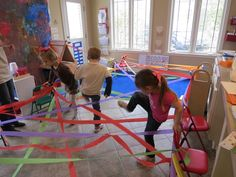 "Weaving through a rainbow- Fun activity that encourages balance, motor planning, coordination and body awareness. Teacher read ""A Rainbow of My Own"" by Don Freeman to go with the activity. Great pic as well, can be a group activity"