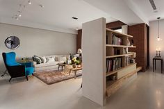 Behind the media center, clever book shelving - including a natural wood ledge - gives extra storage space to the main living area.