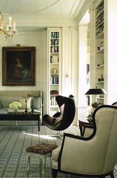 Jacobsen chair and straight-line sofa add interest to otherwise traditional room