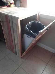 Hide a way trash can...made from old pallets.
