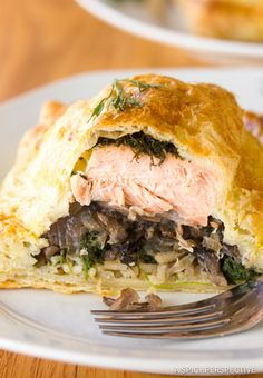 Coulibiac of Salmon Recipe, tender salmon fillets layered with rice and mushrooms, wrapped in puffed pastry. A traditional Russian dish for the holidays.