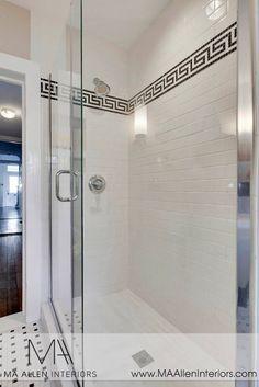 Subway tile shower surround with black greek key