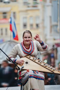 A girl playing gusli, the oldest Russian multi-string plucked instrument. #Russia