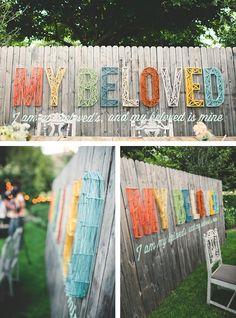 """I am my beloved and my beloved is mine"" DIY wedding backdrop"