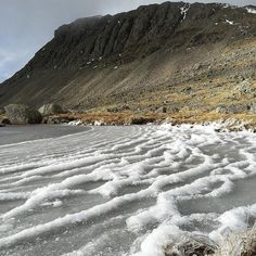 Waves of snow and ice at Three Tarns looking towards Bowfell #bowfell #LakeDistrict #cumbria #mountains #mountain #tarn #ice #water #frozenwater #winter #landscape #bowfell #greatbritain #greatoutdoors #adventureawaits #hiking #wainwright #instagood #instagram #photooftheday #instalike #instadaily #mountainridge #frozenlandscape