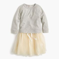 The cozy sweatshirt top and tutu cool skirt on this dress make it comfy…