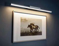 Schilderij (direct) verlicht met een wandarmatuur