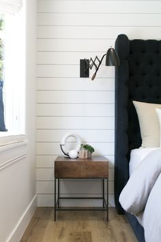 Modern Farmhouse interior design by Lindye Galloway Design. Master bedroom side tables, shiplap wall, and accordion style sconce.