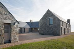 Architecture, Exterior Rustic Farm House Design With Grey Roof And Stone Wall Plus Gravel And Lawn Garden: The Breathtaking Rustic Residence...