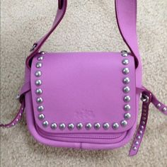 Coach Rivet Dakota 15 Shoulder Bag Coach calf leather Rivet Dakota 15 Shoulder Bag in WR/Puce (light purple) color, silver hardware, flap top, brand new with tags.  Originally $350.  Please let me know if you have any questions, thank for looking! Coach Bags Shoulder Bags