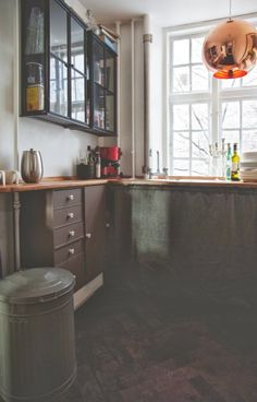 Black kitchen with wood and copper