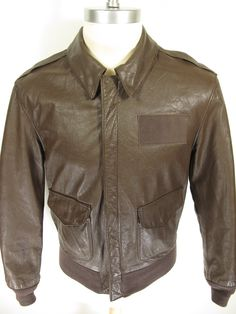 Vintage 80s Cooper A-2 bomber flight leather jacket. Find more men's and women's authentic vintage clothing at The Clothing Vault.