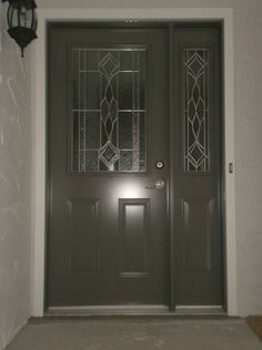 Melbourne glass insert by ODL, Slate coloured single entry door with one sidelite.