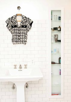 Hate the shirt, love the in-the-wall skinny bathroom cabinet.