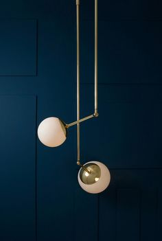 // Lumiere by Paul Matter features lamps with rounded shades made from beaten brass
