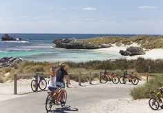 """Cycle Rottnest Island, Western Australia. There are almost no private vehicles. """"Under Regulation 46 of the Rottnest Island Authority Regulations 1988, a person shall not, without permission, use a vehicle on Rottnest Island"""" See: http://www.ccentre.wa.gov.au/175thAnniversary/HeritageIcons/Pages/May-RottnestIsland.aspx and http://en.wikipedia.org/wiki/Rottnest_Island"""