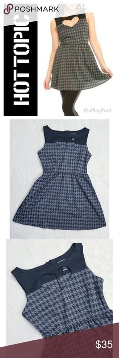 "NAME YOUR PRICE Hot Topic Houndstooth Flare Dress Hot Topic brand adorable houndstooth dress featuring a heart cut out neckline. Fit and flare style is ultra flattering. Layer with tights, boots, and a cardigan for colder weather. Excellent pre-owned condition. No visible flaws.   Approximate measurements (laying flat): Bust - 34"" Length - 31.5"" Hot Topic Dresses"