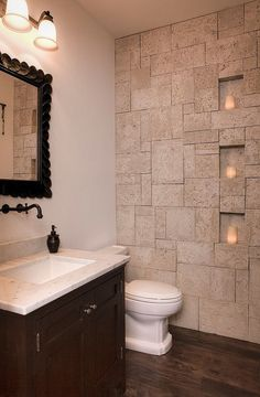 Small bathroom idea with coral stone veneer on the wall [Design: Gary J Ahern, AIA - Focal Point Design]