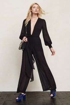 Sometimes it's nice to show off a bit without really showing anything. The Veruschka Jumpsuit is a wide-leg, sheer georgette jumpsuit with a plunging neckline, smocked cuffs and a fitted waist (self belt included). It's also got hook/zip closures and partial lining. We've got you covered. Kind of. https://www.thereformation.com/products/veruschka-jumpsuit-black?utm_source=pinterest&utm_medium=organic&utm_campaign=PinterestOwnedPins