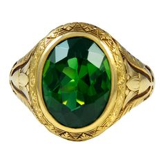 A Green Tourmaline and Gold Ring | From a unique collection of vintage solitaire rings at http://www.1stdibs.com/jewelry/rings/solitaire-rings/