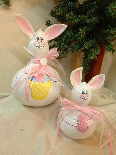 Hand painted pair of white Easter bunny gourds with pink ears and ribbons holding eggs and basket by Debbie Easley by WeAreOutofOurGourds on Etsy