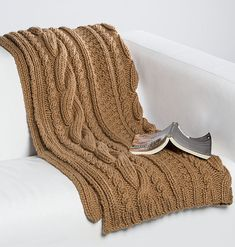 Free Knitting Pattern for Quick Honey Bun Blanket - This cable afghan is a quick knit in super bulky yarn. Designed by Stitch Studio Design Team.