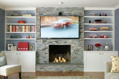 Nice stone fireplace front with flanking bookcases Sharon L. Sherman, ASID, CKD, CID | Find A Designer | ASID New Jersey Chapter