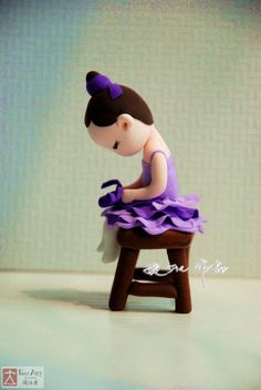 Ballerina sitting on stool