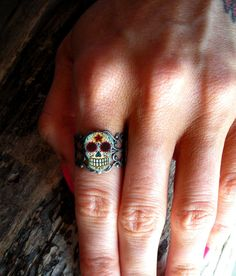 Day of the Dead Filigree Sugar Skull Ring in an Antiqued Silver Finish. $9.95, via Etsy.