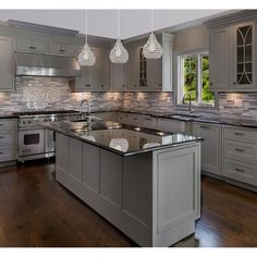 There is no question that designing a new kitchen layout for a large kitchen is much easier than for a small kitchen. A large kitchen provides a designer with adequate space to incorporate many convenient kitchen accessories such as wall ovens, raised. Kitchen Redo, Kitchen Layout, Home Decor Kitchen, Kitchen Interior, Kitchen Dining, Dining Room, Grey Kitchen Cabinets, Kitchen Hacks, Kitchen Backsplash
