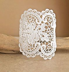 Diy lace cuff.  Use either a scrap of lace or buy a lace motif.  Attach a length of ribbon to both ends for fastening. If your good with a needle & cotton add some beads & crystals.