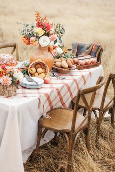 a chic and bright Thanksgiving table with bright florals, white pumpkins in cloches and a plaid tablecloth Thanksgiving Table, Thanksgiving Decorations, Seasonal Decor, Harvest Party Decorations, Fall Home Decor, Autumn Home, Autumn Fall, Fall Picnic, Welcome Fall